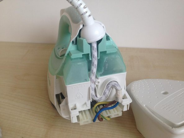 You can now remove the mains cord inlet half-ball from its socket and the cord  from the strain relief S-bend.