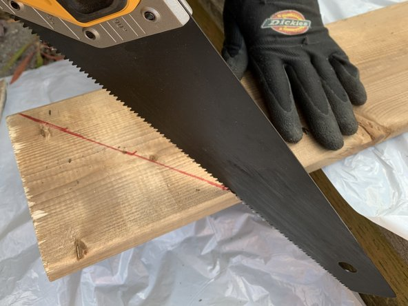 Use a hand saw to cut along the marked cutting line for each new board.