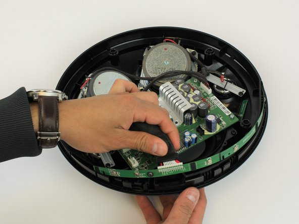 Gently remove the control board band by placing fingers in contact with it through the button openings.