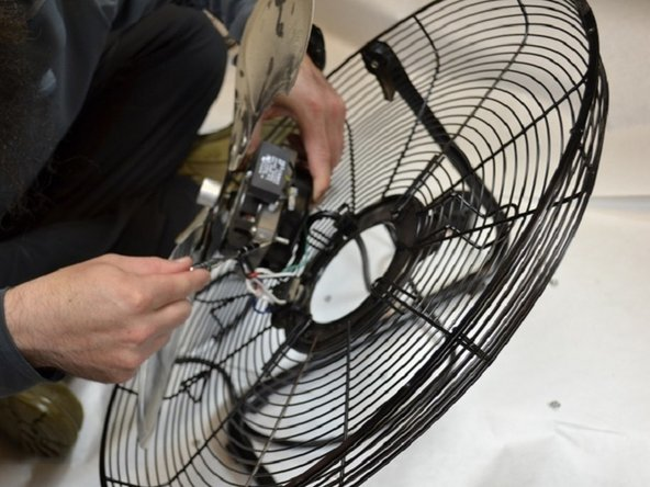 The fan is fully disassembled; replace the damaged parts.