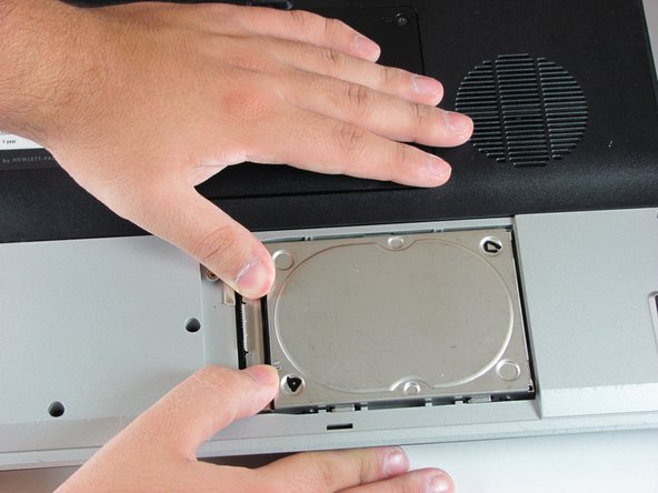 Slide the hard drive to the right until the edge of the hard drive is flush with the computer frame.