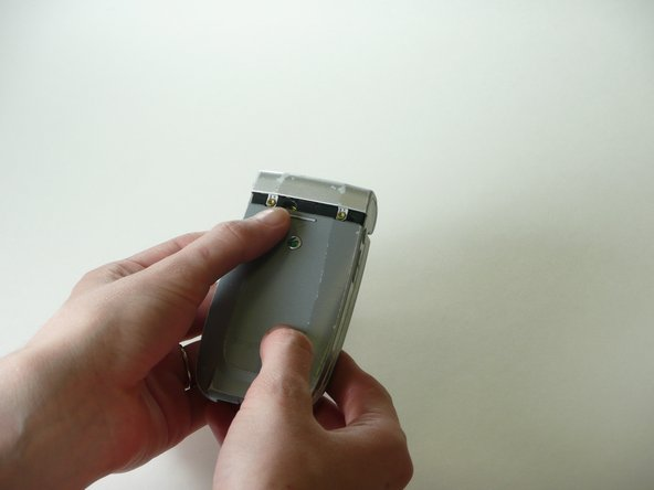 Remove the back cover and the battery.