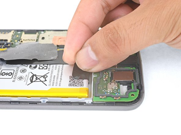 Peel the black pull tab from battery and pull slowly but firmly to separate the battery from the frame.