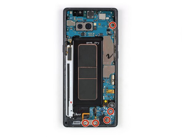 Remove the five Phillips #00 screws that hold down the motherboard, daughterboard, headphone jack and the charging port.
