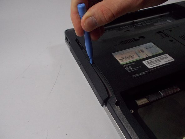 Use any tool with a flat edge in order to pry out the CD-Drive, preferably a plastic opening tool.