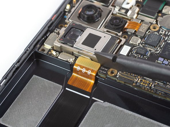 Use a spudger to pry up and disconnect the display flex cable from the motherboard.