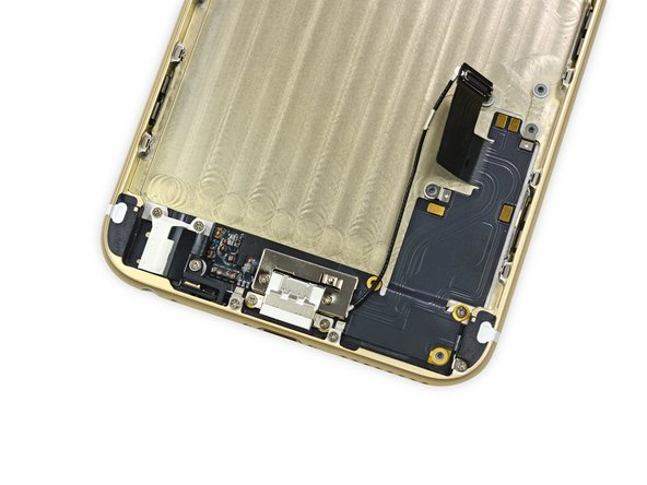 The Lightning connector assembly is comprised of the headphone jack, Lightning connector, and a few antenna connectors.