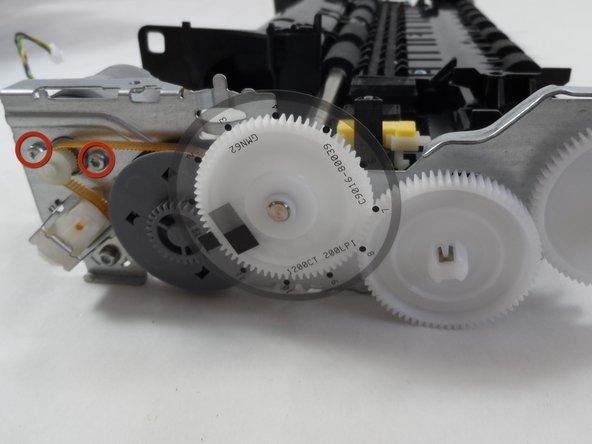 Remove the two 6mm torx screws using a T9 Torx bit.