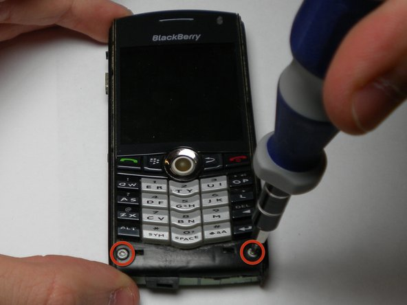 Using a 1.5mm Hex screwdriver, unscrew the two screws, located on the front of the phone, that connect the back and front panels.