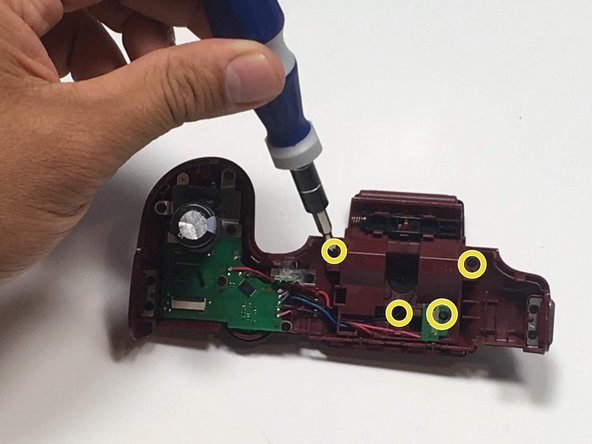 Remove four 1.2 mm Phillips #00 screws from the flash assembly