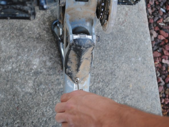 Remove the 10mm screw and take the bash guard off of the frame.