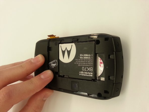Remove the battery cover of this device by sliding it down and then lifting it up.
