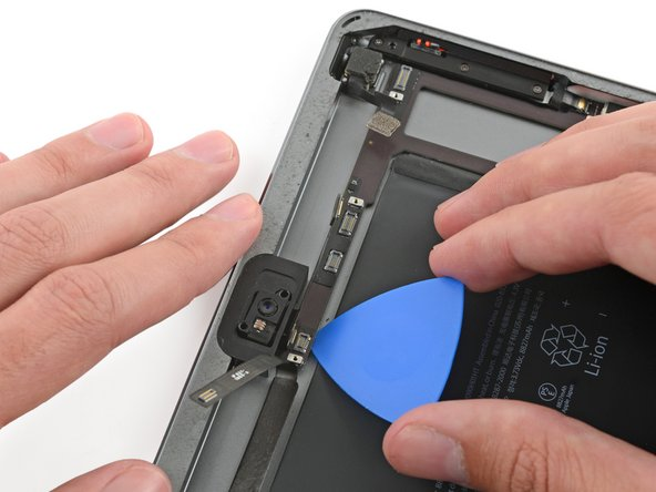 As you complete the next few steps, prying adhesive securing the logic board in place, always start by testing gently to see if the adhesive is softened. If not, reheat the iOpener and reapply it to the back of the rear case.