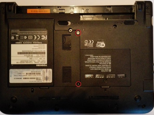 Now remove the two screws (T6 Torx) of the hard drive and wireless card cover.