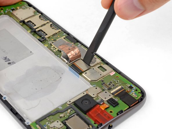 Use your spudger to disconnect the display by prying its connector straight up from the motherboard, on the edge nearest the side of the phone.
