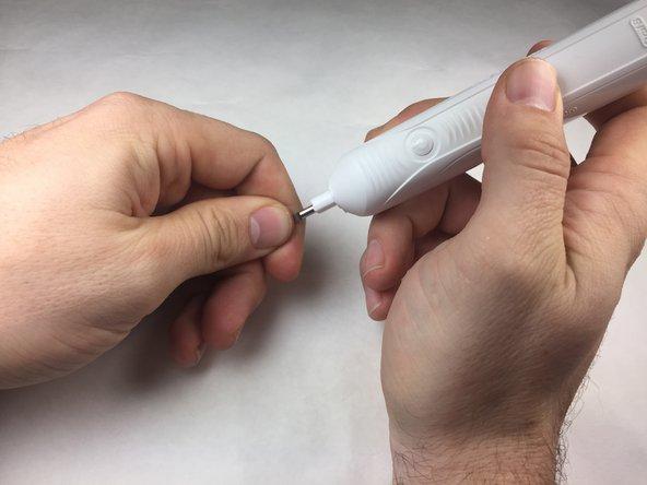 Apply pressure on the brush shaft to release the toothbrush internals.