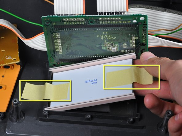 Remove tape from the LCD screen and remove the screen completely.