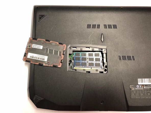 Remove the RAM cover by lifting the screw cover and pulling away firmly.
