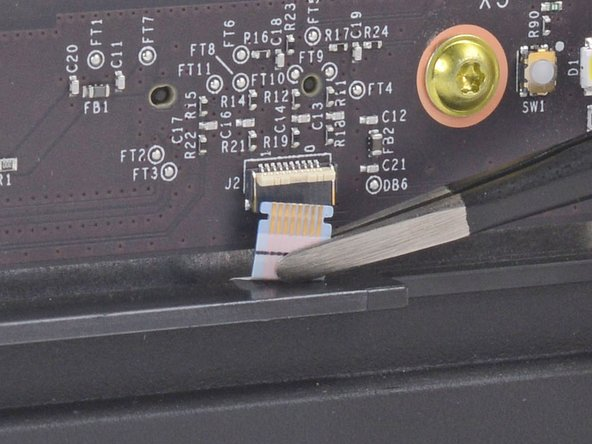 Use blunt tweezers to pull the ribbon cable down out of the connector.