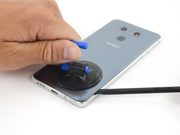 Once the back panel is warm to the touch, apply a suction cup as close to the heated edge of the phone as you can.