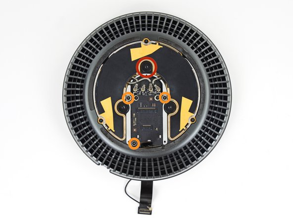 Remove the following screws from the top of the fan assembly:
