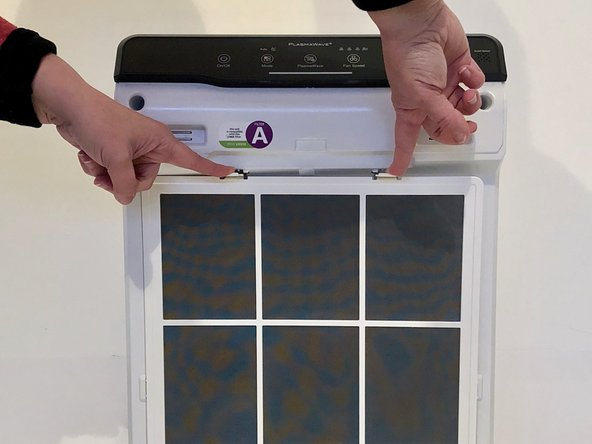 Detach the air intake screen by placing your fingers on the top two hinges.