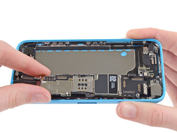 Flip the logic board up toward the volume control buttons to expose the antenna connector.