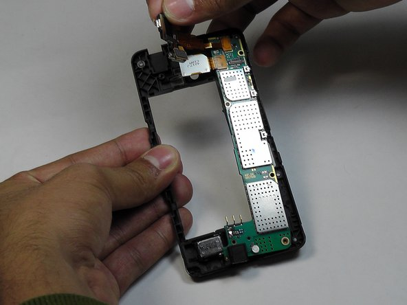 Carefully retrieve the camera and audio jack's flex that is attached to the mother board as shown in the picture.