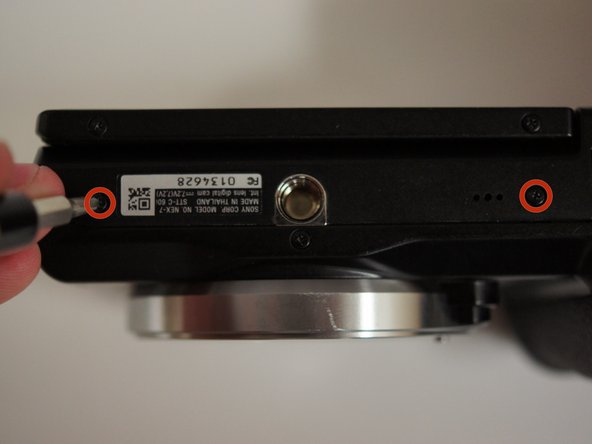 """Start by removing the two 5/32"""" #00 screws on the bottom of the camera using the Phillips #00 screwdriver."""