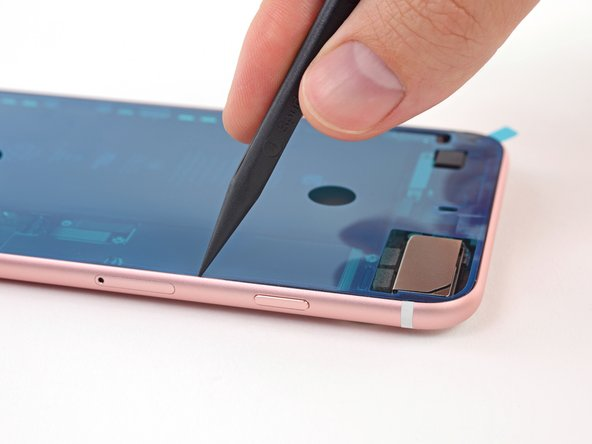 Use the tip of a spudger to press all the adhesive into place around the entire perimeter of your iPhone.