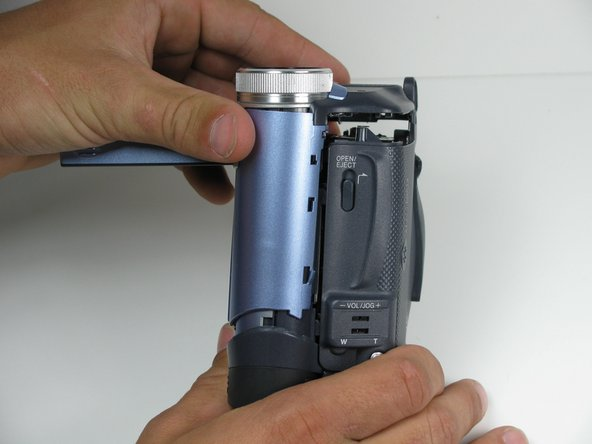 Very carefully remove the front cover from the main body of the camcorder.