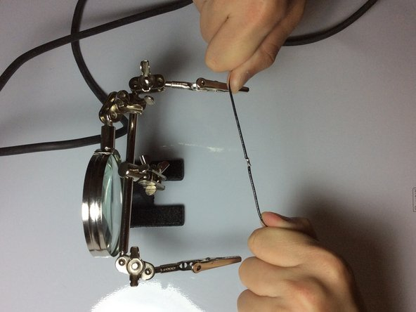 Pull on the two wires firmly to ensure the solder does not separate.