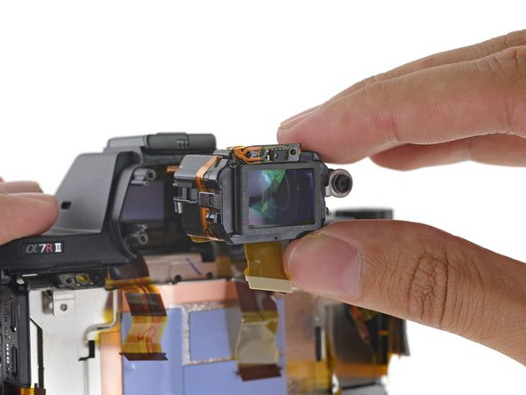Back to the viewfinder—turns out we can pull it straight out of its cavity. With its frame previously dispatched, it was only held in place by a gummy thermal pad.