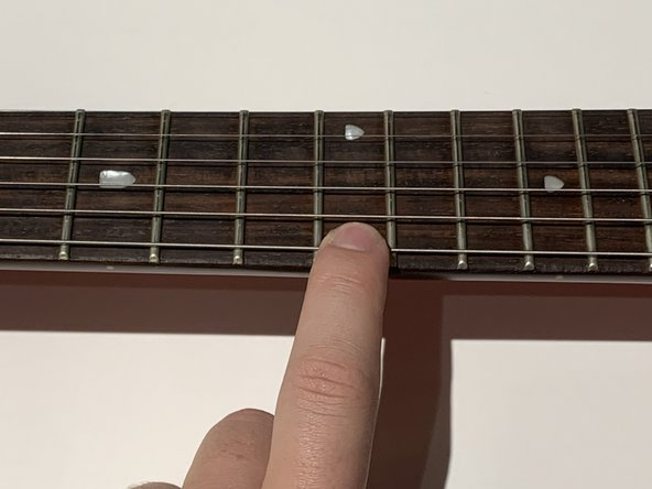 Check your sting intonation by pressing the string down at the 12th fret and playing a note.