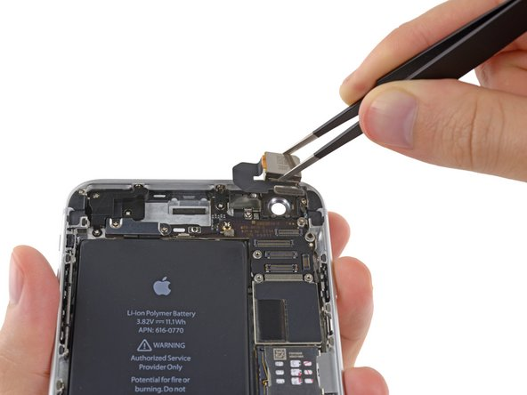 Carefully lift and remove the rear-facing camera out of the iPhone.