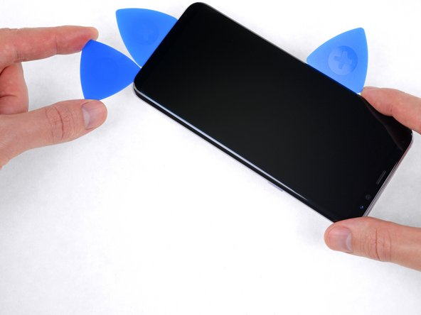 Use your opening pick to separate the adhesive under the right edge of the display.