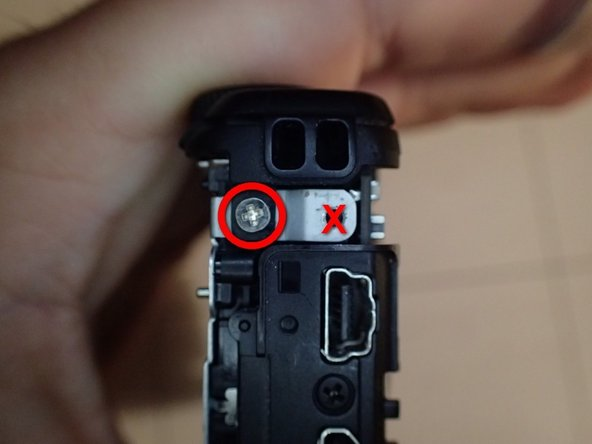 When replacing the top case, remember that the end screw goes on the right end of the camera (the screw hole on the left end is filled by one of the outer case screws). There are two screw holes on the right end - this screw goes in the hole on the left/closer to the rear of the camera (again, the other is for one of the outer case screws).