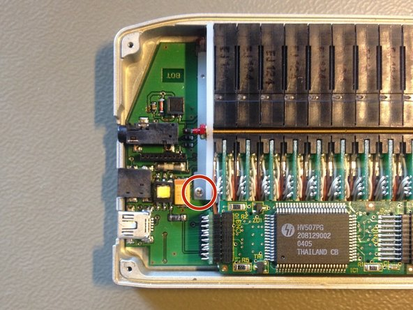 Remove the two screws with a Phillips #00 screwdriver on the logic board.
