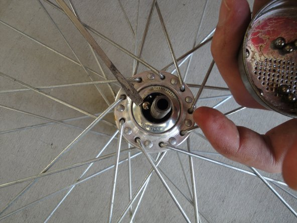 Insert 10 bearings into the topmost bearing races.
