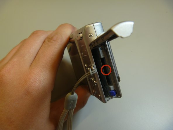 Ensure that the memory card lines up properly with the slot in the camera.