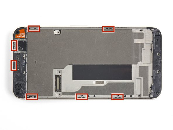 The midframe is held tightly in place by plastic clips which push into the edge of the back case.