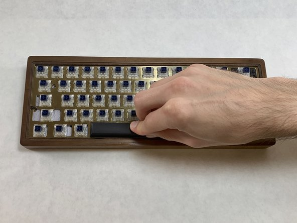 Place the cleaned keycaps onto their correct position on the keyboard.