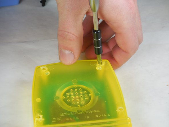 Use a Phillips 1 screwdriver to unfasten the four screws from the back of the case.