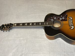 How to Clean and Restring an Epiphone EJ-200 Acoustic Guitar