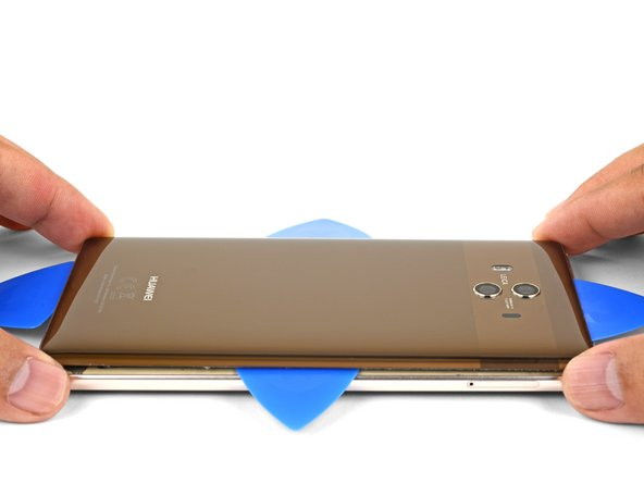 After you cut through the adhesive around the entire perimeter of the back cover, begin to lift it away from the phone.