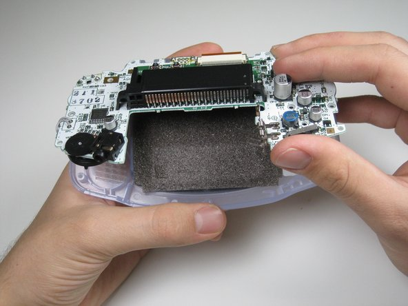 Pull circuit board away from the front panel by pulling up at the bottom of the circuit board, keeping the top ribbon still connected.