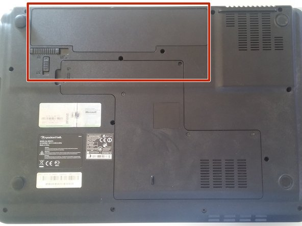The battery is located on the top left corner of the backside of the device.