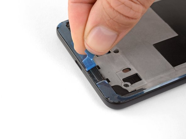 When you are ready to seal the phone, carefully peel away the blue backing without peeling the adhesive off of the phone.