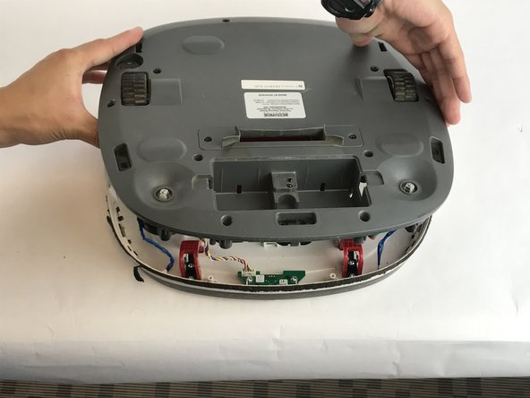Carefully lift the back cover from the body of the Deebot