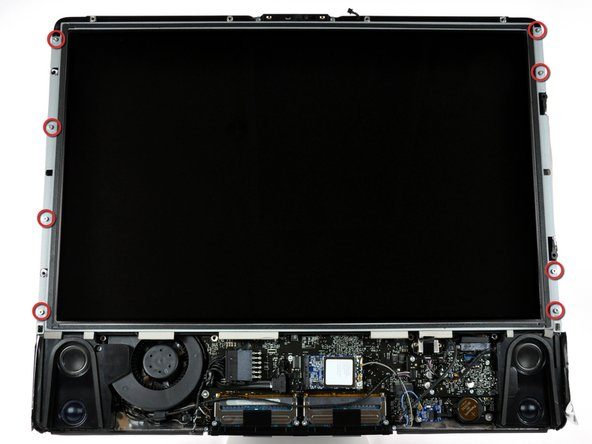 Remove the eight T8 Torx screws securing the display panel to the rear case.